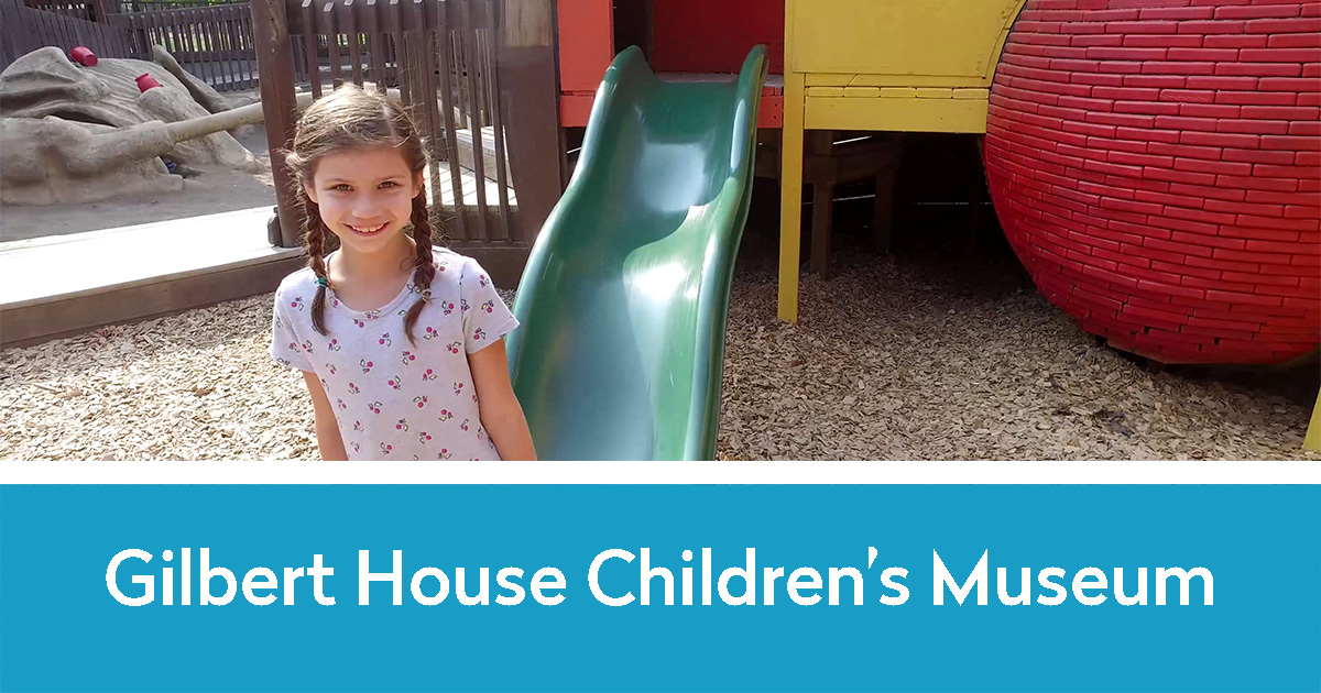 Little girl by a play structure at the Gilbert House | Gilbert House Children's Museum