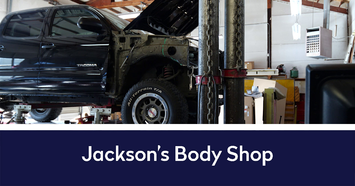 Jackson's Body Shop below a picture of the interior of the shop with a truck