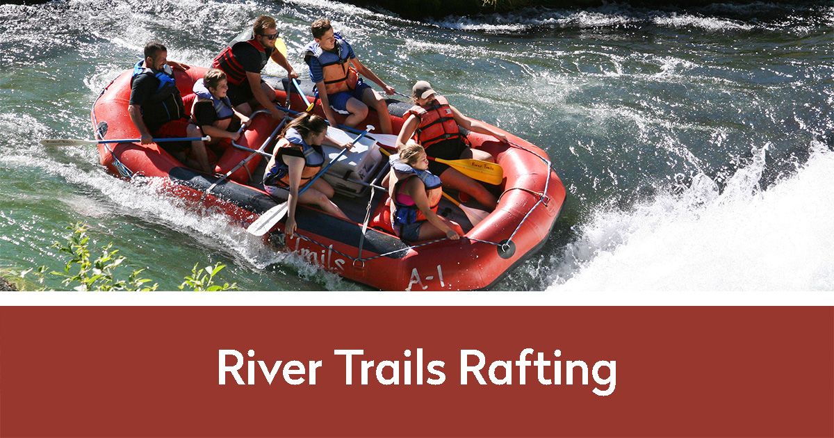 River Trails Rafting in Maupin, Oregon photo of a group of people rafting down the Deschutes river with River Trails Rafting below