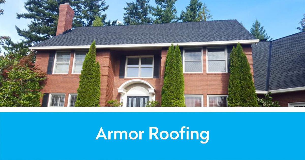 Armor Roofing logo and a stately brick house with a new roof by them