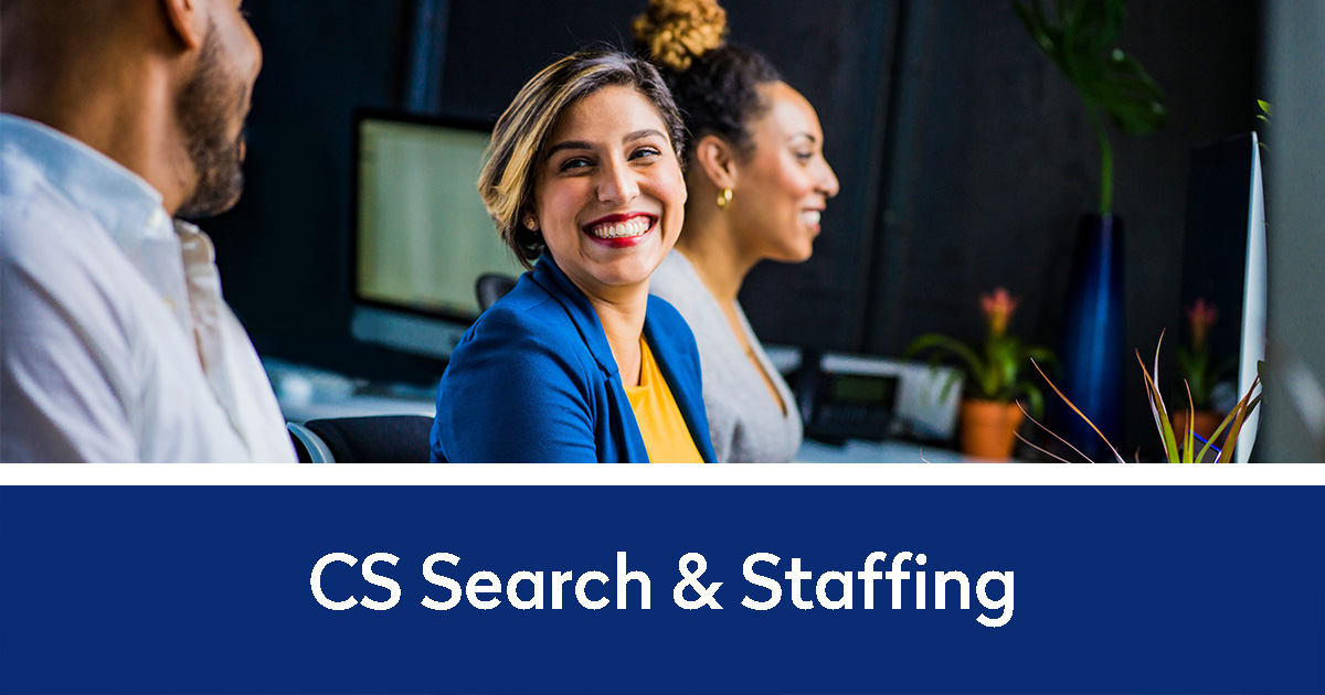 Woman worker smiling at male worker at a meeting | CS Search & Staffing