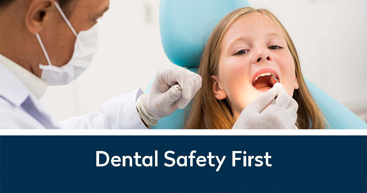 Dental Safety First and a dentist examining a child's mouth