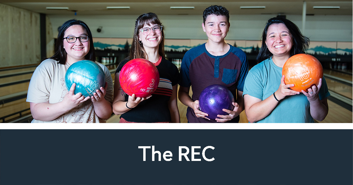 Teens holding bowling balls at The REC | The REC