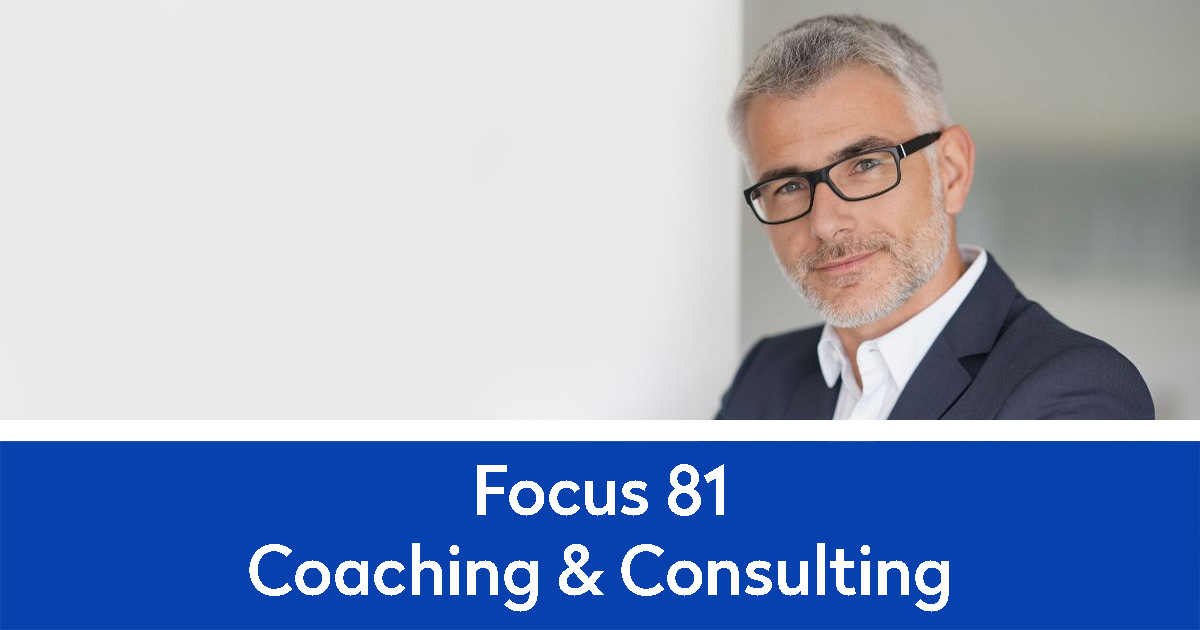Focus 81 Consulting with a businessman leaning against a white wall