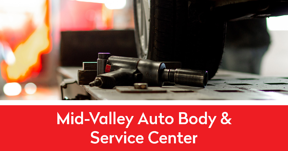 Wheel and tool in the Mid-Valley Auto Body shop | Mid-Valley Auto Body & Service Center