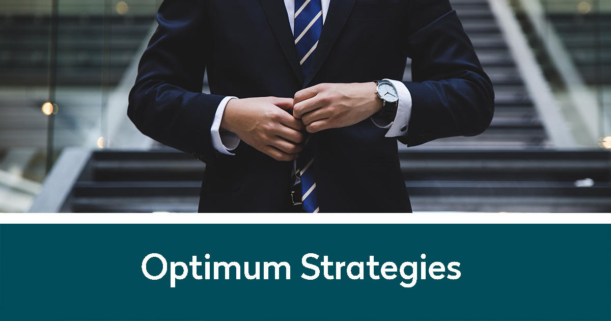 Business man buttoning his suit going down stairs | Optimum Strategies